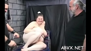 Amazing floosy is masturbating next to her fireplace