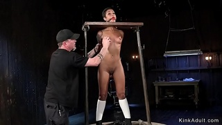 Strapped to wooden device ebony punished