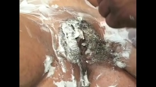 Young ebony Brown Pleasure gets her pussy shaved by a stud before he fucks her