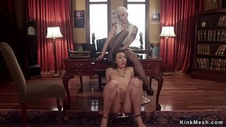 Blonde whips lesbian in upside down suspension