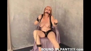 MILF Brandi bound and gagged on the couch