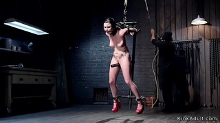 Helpless brunette in metal devices