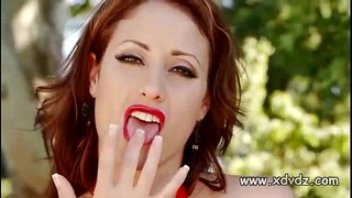 Incredible Redhead Eva Notty Models Her Beautiful Body On Top Of A Luxury Car